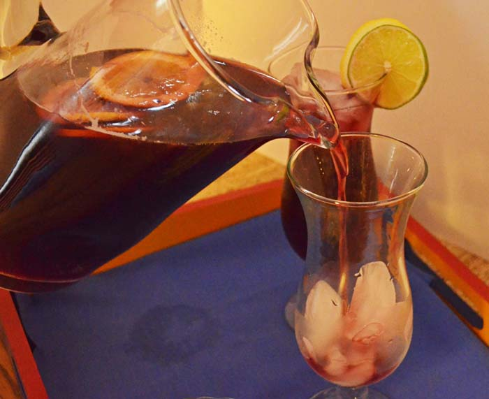 pouring a glass of sangria photo